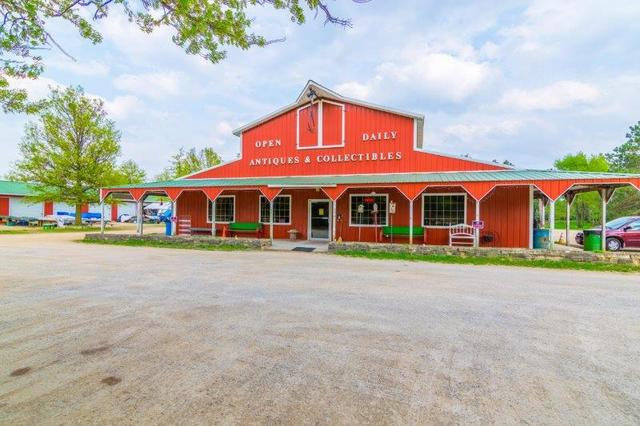 "Business Possibilities!  2017 Traffic Count is 7900 per IDOT. The present business was started in 1998, located on GREAT RIVER ROAD (RT 84) on 10 acres.  (Approximately 8 acres are zoned various commercial designations)  Presently used for an antique mall (60' x 120)' & flea market (using 3 buildings each 24' x 108') Open air pavilion is 30' x 120'. You could add doors, etc to create another purpose. Lots of parking available. The flea market buildings could become mini storages. The 60' x 120' building is getting its lighting switched out to LED and the heat has never been over $150 per month.  One a/c unit was replaced in 2017.  There are 2 commercial size septic systems, the sand point well is tested quarterly by the State of Illinois. This property offers flexibility for what your ""dream"" may be!"