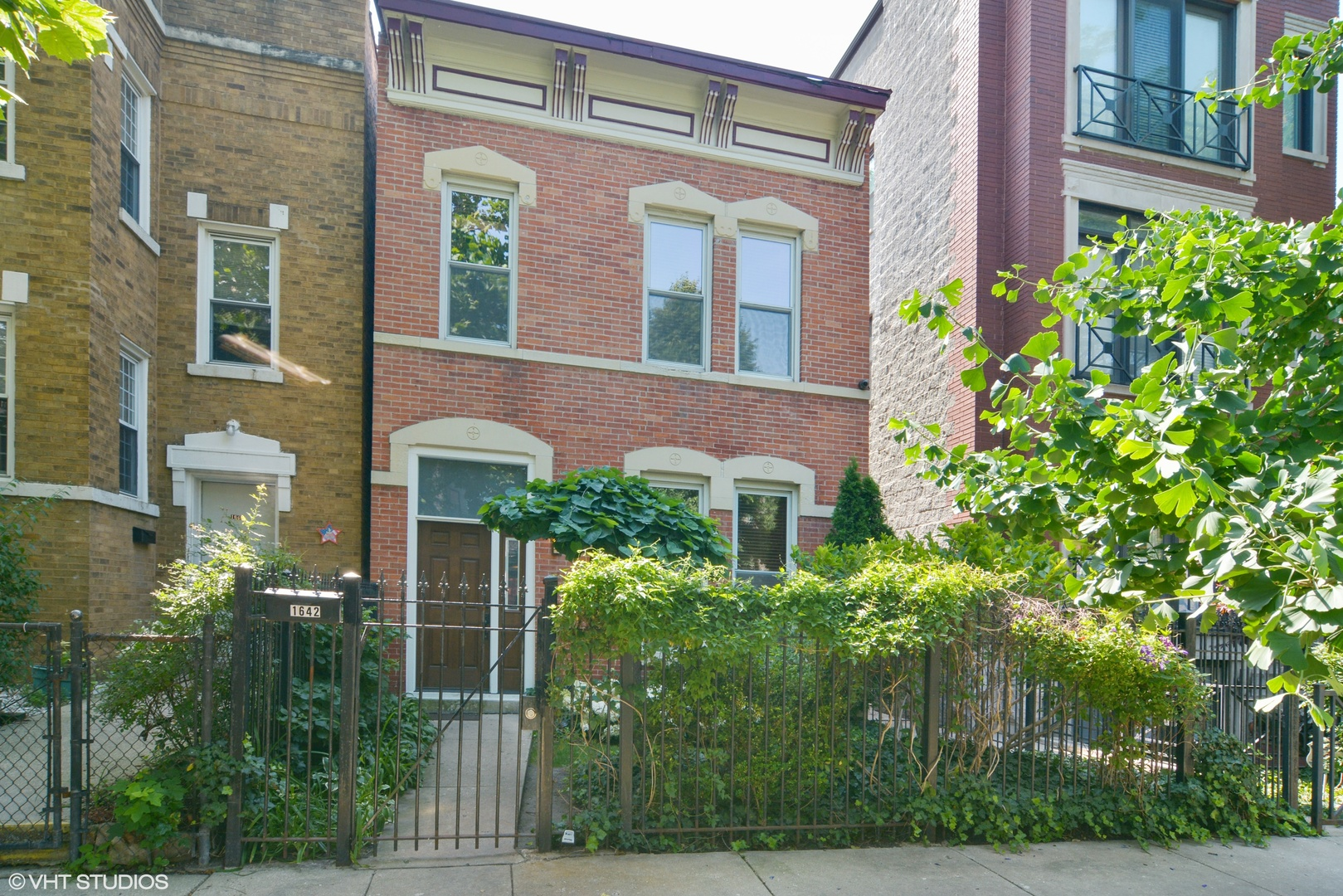 """Gorgeous 2-story, all brick home in the heart of Bucktown.  This home features 3 bedrooms, exposed brick, 10 foot ceilings, large windows, fireplace, and hardwood floors throughout. The home has been impeccably maintained, including a beautifully landscaped yard with perennial garden, master bedroom with built in closet, 42"""" Cherry Cabinets in a kitchen that overlooks the back deck. Detached 2 car garage.  The home has been freshly painted and is in move in condition.  Walking distance to the Blue Line, the 606 Entrance, and vibrant North Ave / Damen intersection. Broker owned with many high end improvements over the years.  Best Buy in Bucktown."""
