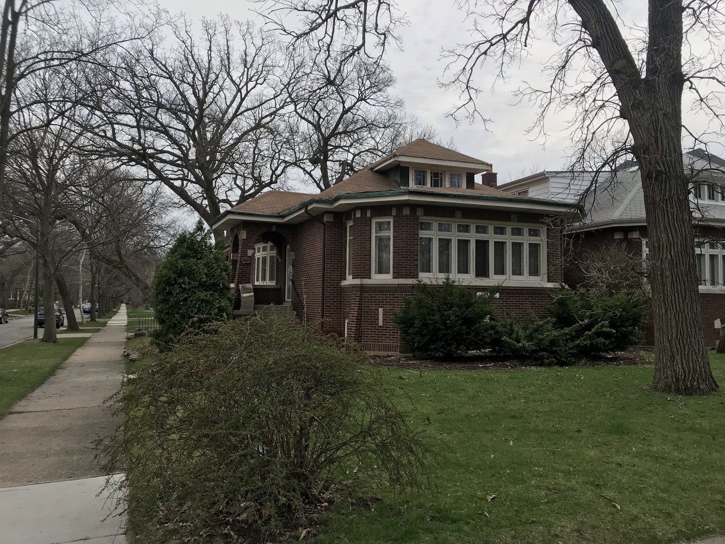 This home is a gorgeous old bungalow that could use some work and is priced accordingly. Bright light streams through mature oaks and through beautiful stained glass in the front living room. Full unfinished basement ready for your finishes. Three minute walk to Metra, CTA, and downtown Beverly.  A truly precious family home ready for its new family!