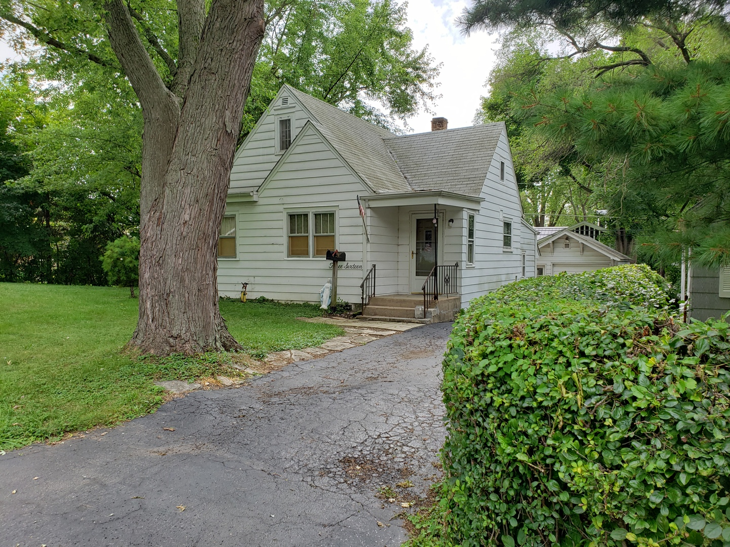 Quaint cape cod with long time owner is now ready to sell!  This cute home comes with a second buildable lot on a separate PIn.  No need to look for anything more affordable than this.  Owner is moving to warmer climates and wants to retire fully.  This home has everything one could need, easy step kitchen laundry, garage, extra space or room for family or guest, and even tons of yard space for the pets if need be.  Priced to sell quickly so come get it while it's hot!
