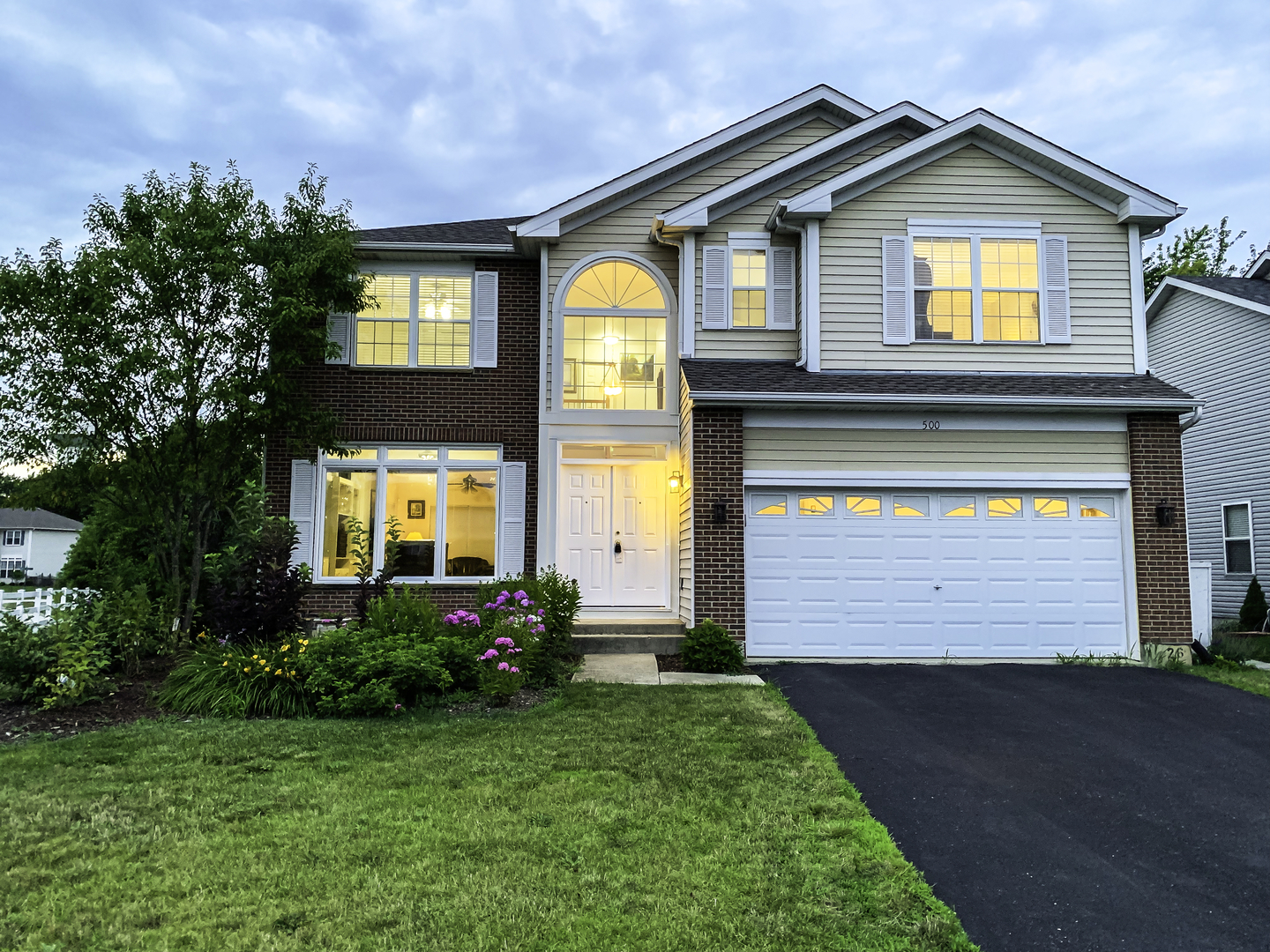 Welcome to this fantastic, move-in ready home nestled in the stunning Hidden Ponds subdivision!  You'll fall in love with everything this property has to offer from the moment you arrive.  You'll adore the dramatic 2 story Foyer, open layout, gleaming wood floors, cozy fireplace, spacious Kitchen w/gorgeous glass mosaic tile, large island, & huge walk-in pantry!   Enjoy a truly enormous Master Suite with walk-in closet and whirlpool tub in the private Master Bath!  Plus, extra windows throughout for tons of light, multiple closets and storage areas, beautiful yard with shed, and a walk-out basement that is just waiting for your finishing touches - Too much to list!  Extra large, professionally landscaped corner lot located within minutes of the train.  This is THE ONE you've been waiting for so hurry to come see it, fall in love, and make your offer today!