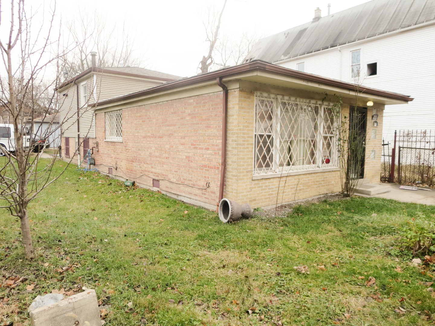 Great investment on this spacious brick split level in upcoming neighborhood. Close and collect rent right away.  Property was fully rehabbed in 2011 including tear off  roof ( house and garage), hardwood floors, furnace and water heater, security fence, kitchen cabinets etc. Currently being rented.
