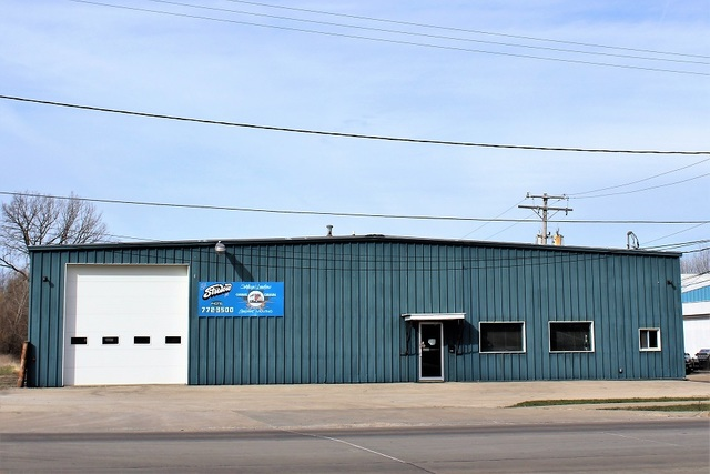 "Seller is willing to divide the property. Commercial Possibilities!  The front building offers 8640 square feet, With office, parts room and the 80' x 100' heated shop area has a ""drive thru"" lane. There are new ceiling lights and the walls have been redone and insulated.  Additionally, there is 3 sided building 60' deep and 144' long. Further to the rear is another enclosed building 60' x 66' with electricity. City water and sewer.  All this on 2.828 acres."